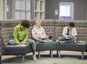 Students reading on couches outside the classroom
