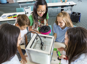 Teacher and students with 3D printer